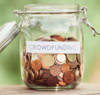 Money jar labelled Crowdfunding
